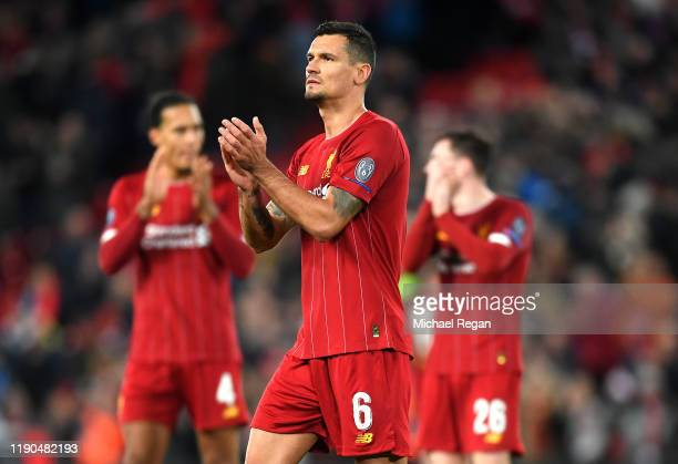 Dejan Lovren of Liverpool acknowledges the fans following the UEFA Champions League group E match between Liverpool FC and SSC Napoli at Anfield on...