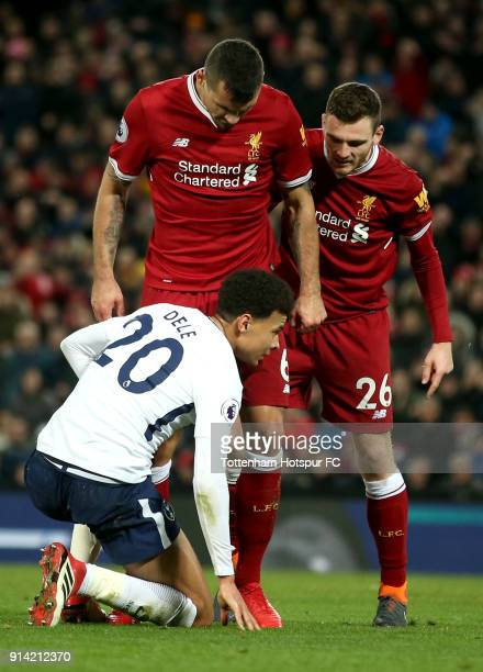 Dejan Lovren of Liverpool and Andy Robertson of Liverpool argue with Dele Alli of Tottenham Hotspur after he is accused of diving during the Premier...
