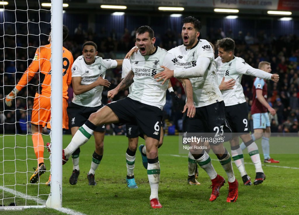 Dejan Lovren of Liverpool and Emre Can of Liverpool celebrate there sides second goal of the game during the Premier League match between Burnley and Liverpool at Turf Moor on January 1, 2018 in Burnley, England.