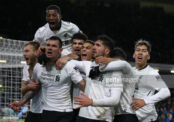 Dejan Lovren of Liverpool and Emre Can of Liverpool celebrate there sides second goal of the game during the Premier League match between Burnley and...