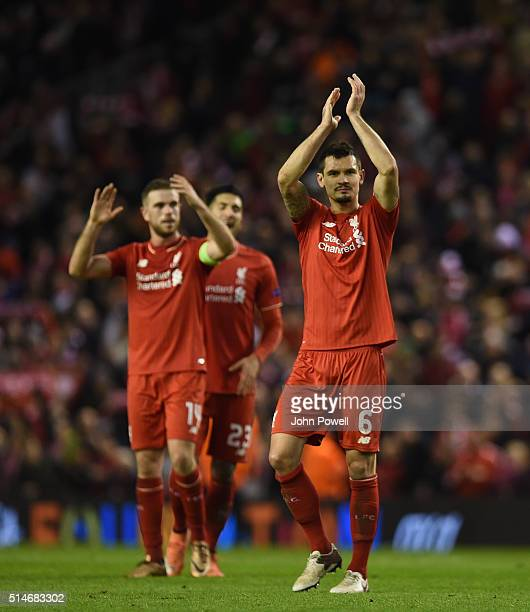 Dejan Lovren of Liverpool and Jordan Henderson of Liverpool celebrate at the end of the UEFA Europa League Round of 16 first leg match between...