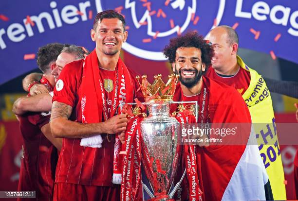 Dejan Lovren of Liverpool and Mohamed Salah of Liverpool pose for a photo with The Premier League trophy following the Premier League match between...