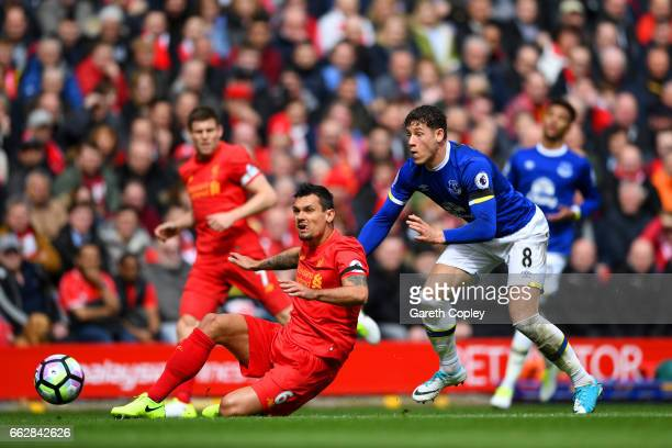 Dejan Lovren of Liverpool and Ross Barkley of Everton battle for possession during the Premier League match between Liverpool and Everton at Anfield...