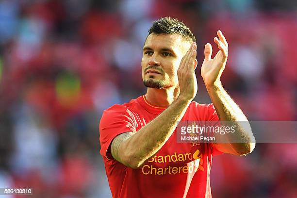 Dejan Lovren of Liverpool applauds supporters following the International Champions Cup match between Liverpool and Barcelona at Wembley Stadium on...