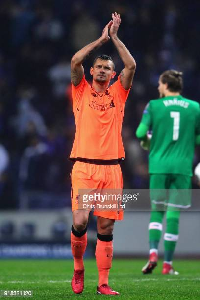 Dejan Lovren of Liverpool applauds the crowd after the UEFA Champions League Round of 16 First Leg match between FC Porto and Liverpool at Estadio do...