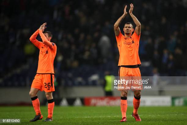 Dejan Lovren of Liverpool applauds the fans at full time during the UEFA Champions League Round of 16 First Leg match between FC Porto and Liverpool...