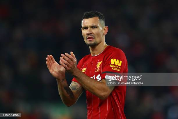 Dejan Lovren of Liverpool applauds the supporters following the Premier League match between Liverpool FC and Brighton & Hove Albion at Anfield on...