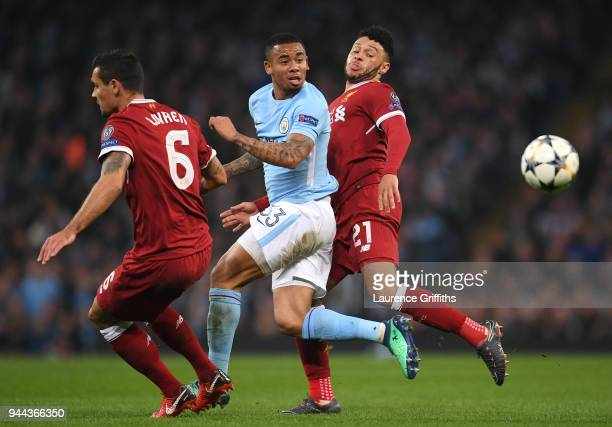 Dejan Lovren of Liverpool battles for posession with Gabriel Jesus of Manchester City and Alex OxladeChamberlain of Liverpool during the UEFA...