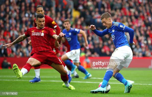 Dejan Lovren of Liverpool battles for possession with Jamie Vardy of Leicester City during the Premier League match between Liverpool FC and...
