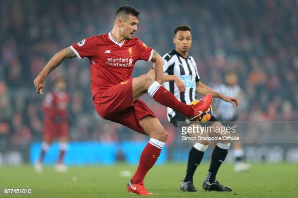 Dejan Lovren of Liverpool battles with Jacob Murphy of Newcastle during the Premier League match between Liverpool and Newcastle United at Anfield on...