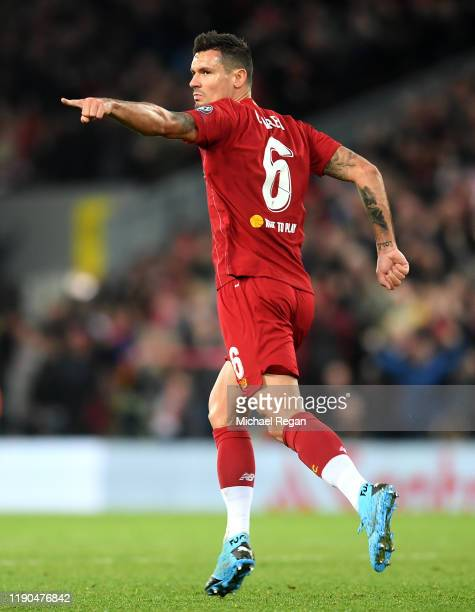 Dejan Lovren of Liverpool celebrates after scoring his team's first goal during the UEFA Champions League group E match between Liverpool FC and SSC...