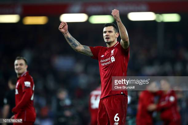 Dejan Lovren of Liverpool celebrates during the Premier League match between Liverpool FC and Arsenal FC at Anfield on December 29, 2018 in...