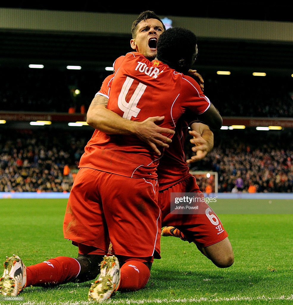 Dejan Lovren of Liverpool celebrates his goal with Kolo Toure during the Capital One Cup Fourth Round match between Liverpool and Swansea City at Anfield on October 28, 2014 in Liverpool, England.