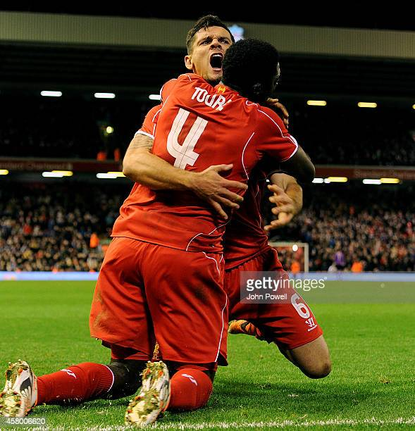 Dejan Lovren of Liverpool celebrates his goal with Kolo Toure during the Capital One Cup Fourth Round match between Liverpool and Swansea City at...