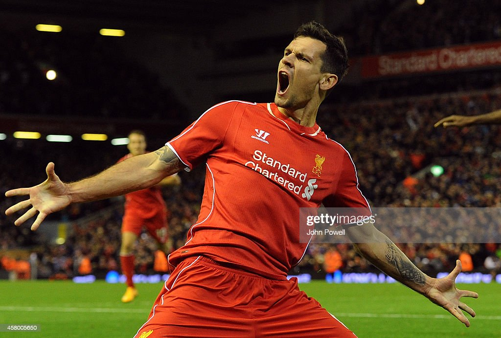 Dejan Lovren of Liverpool celebrates his winning goal during the Capital One Cup Fourth Round match between Liverpool and Swansea City at Anfield on October 28, 2014 in Liverpool, England.