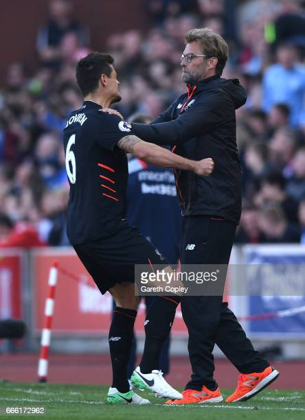 Dejan Lovren of Liverpool celebrates the Liverpool second goal with Jurgen Klopp Manager of Liverpool during the Premier League match between Stoke...
