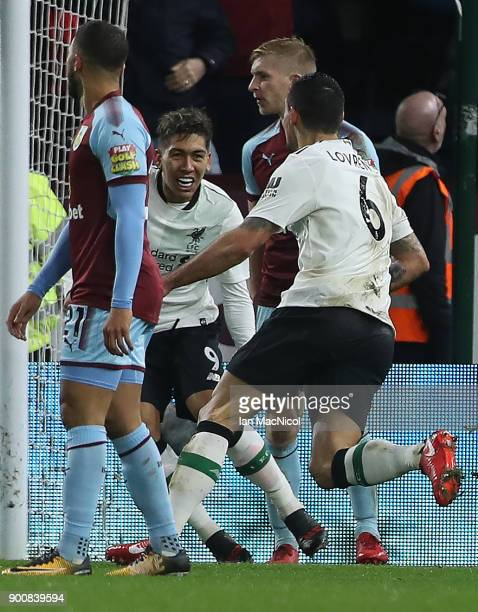 Dejan Lovren of Liverpool celebrates with Roberto Firmino of Liverpool during the Premier League match between Burnley and Liverpool at Turf Moor on...