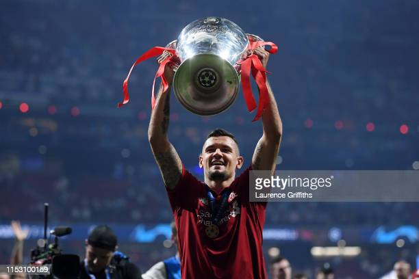Dejan Lovren of Liverpool celebrates with the Champions League Trophy after winning the UEFA Champions League Final between Tottenham Hotspur and...