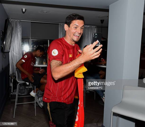 Dejan Lovren of Liverpool celebrating winning the Premier League on June 25, 2020 in Liverpool, England.