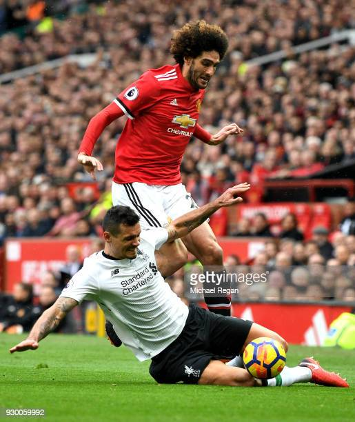 Dejan Lovren of Liverpool challenges Marouane Fellaini of Manchester United during the Premier League match between Manchester United and Liverpool...