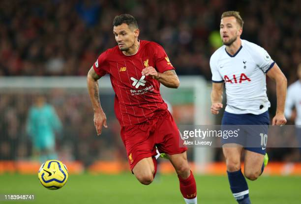 Dejan Lovren of Liverpool chases the ball ahead of Harry Kane of Tottenham Hotspur during the Premier League match between Liverpool FC and Tottenham...