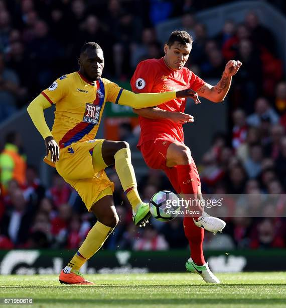 Dejan Lovren of Liverpool competes with Christian Benteke of Crystal Palace during the Premier League match between Liverpool and Crystal Palace at...