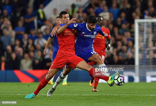 Dejan Lovren of Liverpool competes with Diego Costa of Chelsea during the Premier League match between Chelsea and Liverpool at Stamford Bridge on...