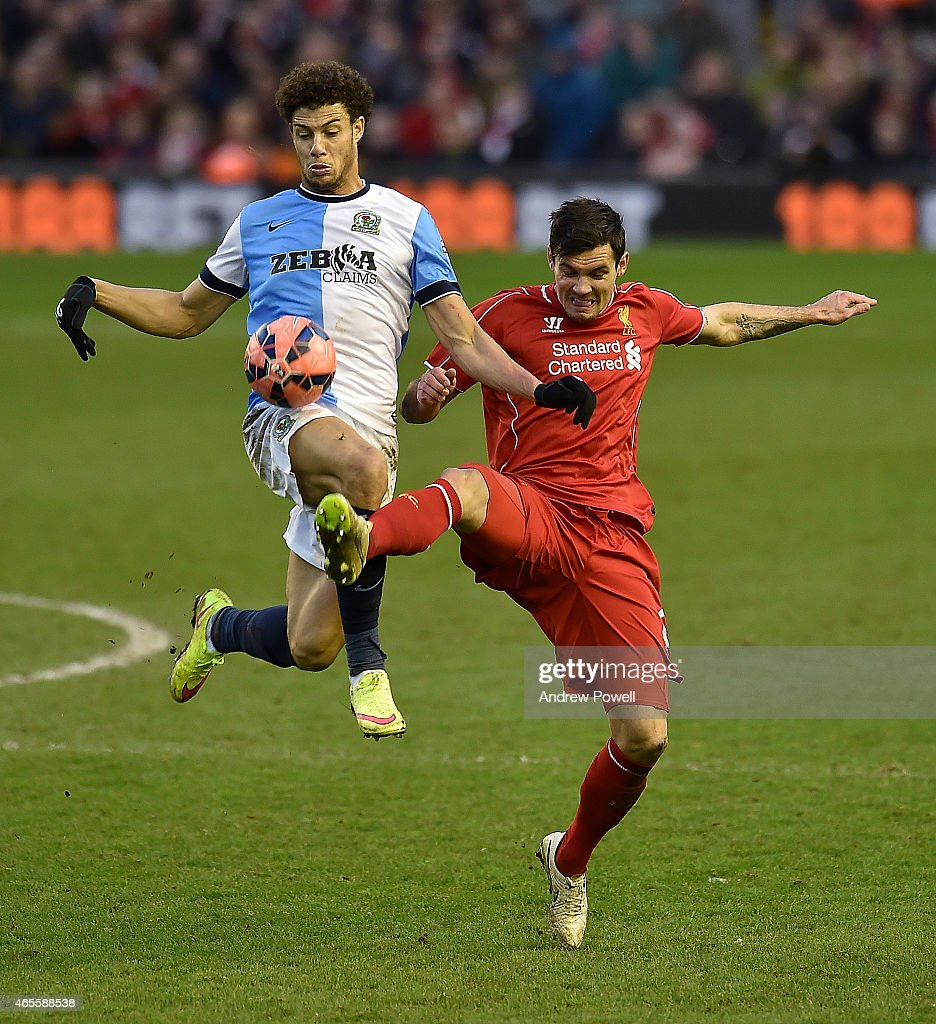 Dejan Lovren of Liverpool competes with Lee Williams of Blackburn Rovers during the FA Cup Quarter Final match between Liverpool and Blackburn Rovers at Anfield on March 8, 2015 in Liverpool, England.