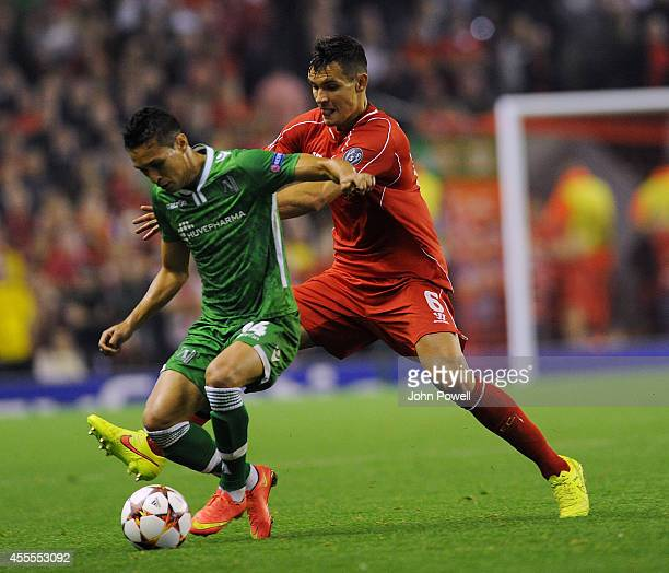 Dejan Lovren of Liverpool competes with Marcelinho of Ludogorets Razgrad during the UEFA Champions League match between Liverpool and PFC Ludogorets...