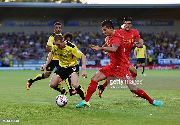 Dejan Lovren of Liverpool competes with Stuart Beavon of Burton Albion during the EFL Cup match between Burton Albion and Liverpool at the Pirelli...