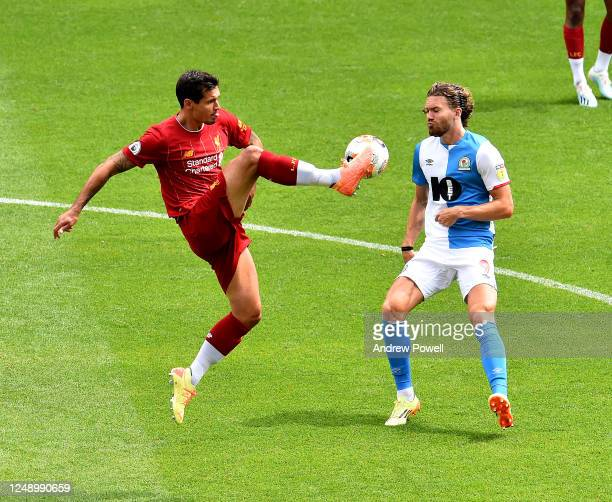 Dejan Lovren of Liverpool competing with Sam Gallagher of Blackburn Rovers during a friendly match between Liverpool and Blackburn Rovers at Anfield...