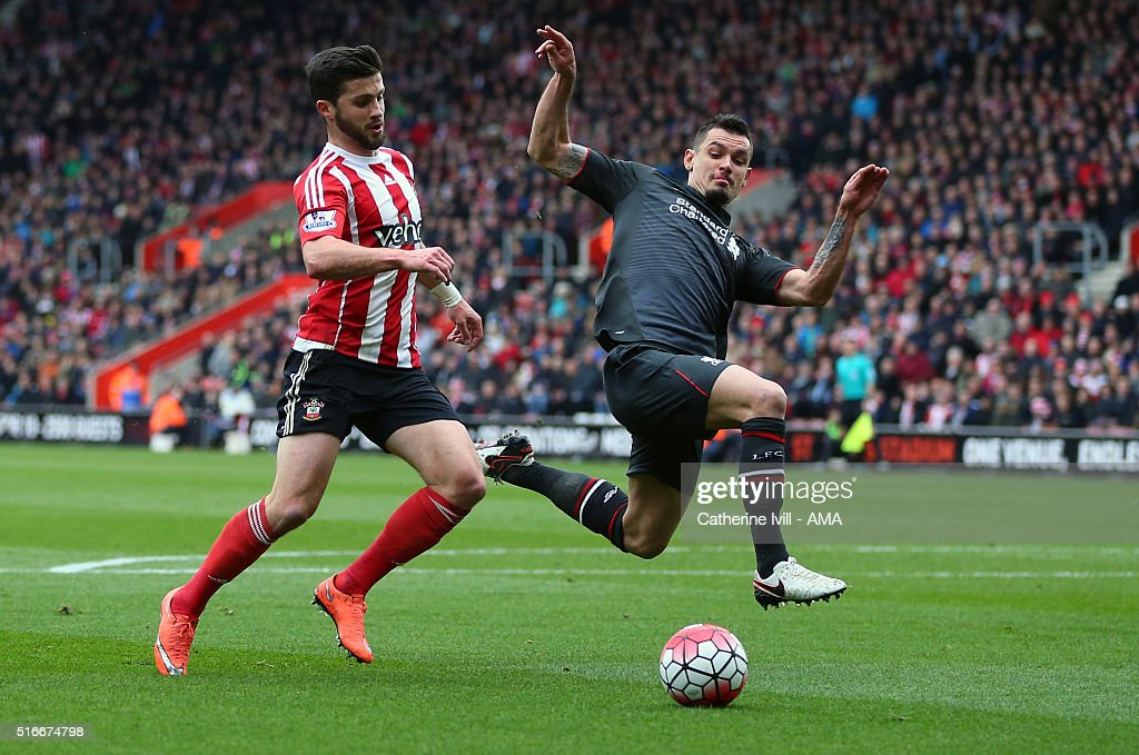 Dejan Lovren of Liverpool defends from Shane Long of Southampton during the Barclays Premier League match between Southampton and Liverpool on March 20, 2016 in Southampton, United Kingdom.