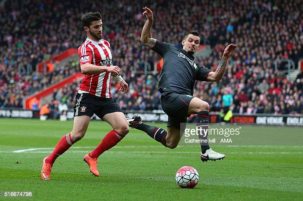 Dejan Lovren of Liverpool defends from Shane Long of Southampton during the Barclays Premier League match between Southampton and Liverpool on March...
