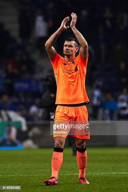 Dejan Lovren of Liverpool FC celebrates his team victory with Liverpool fans at the end of the UEFA Champions League Round of 16 First Leg match...