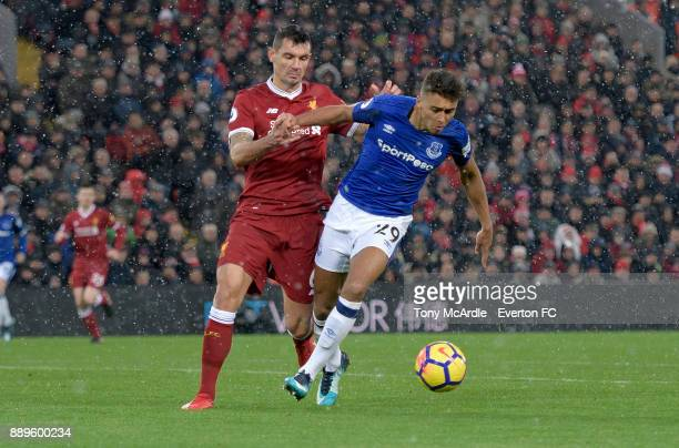 Dejan Lovren of Liverpool fouls Dominic CalvertLewin of Everton to concede a penalty during the Premier League match between Liverpool and Everton at...