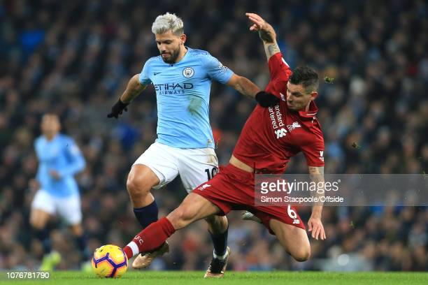 Dejan Lovren of Liverpool fouls Sergio Aguero of Man City during the Premier League match between Manchester City and Liverpool FC at the Etihad...