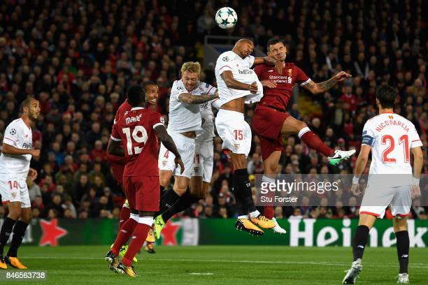 Dejan Lovren of Liverpool heads the ball towards goal during the UEFA Champions League group E match between Liverpool FC and Sevilla FC at Anfield...