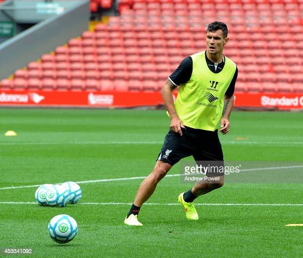 Dejan Lovren of Liverpool in action during a training session at Anfield on August 8 2014 in Liverpool England