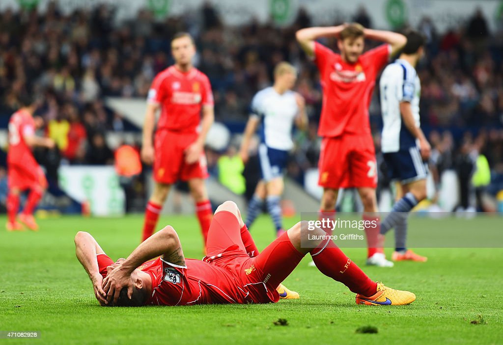 Dejan Lovren of Liverpool lies on the pitch during the Barclays Premier League match between West Bromwich Albion and Liverpool at The Hawthorns on April 25, 2015 in West Bromwich, England.