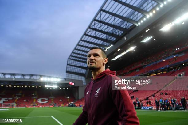 Dejan Lovren of Liverpool looks on prior to the Group C match of the UEFA Champions League between Liverpool and Paris SaintGermain at Anfield on...