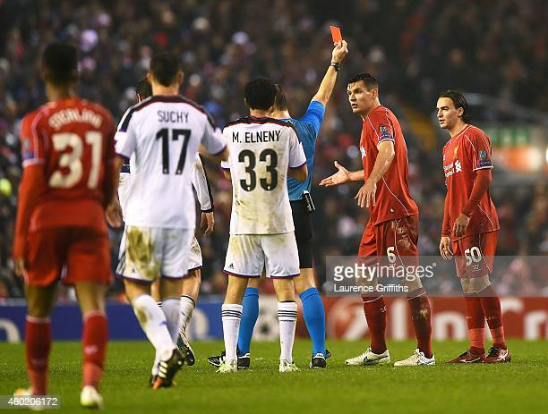 Dejan Lovren of Liverpool reacts as teammate Lazar Markovic of Liverpool is shown the red card card during the UEFA Champions League group B match...