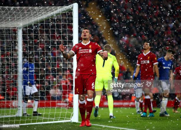 Dejan Lovren of Liverpool reacts during the Premier League match between Liverpool and Everton at Anfield on December 10 2017 in Liverpool England
