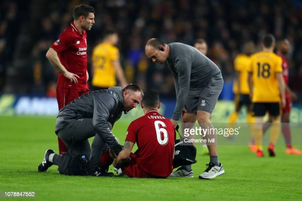Dejan Lovren of Liverpool receives help before leaving the pitch injured during the Emirates FA Cup Third Round match between Wolverhampton Wanderers...