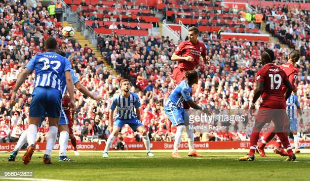 Dejan Lovren of Liverpool scores his sides second goal during the Premier League match between Liverpool and Brighton and Hove Albion at Anfield on...