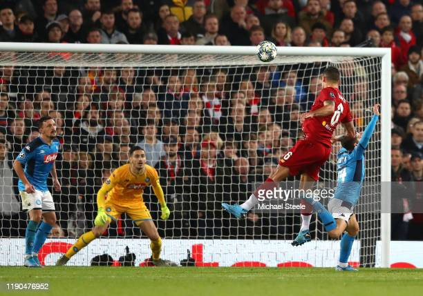 Dejan Lovren of Liverpool scores his team's first goal during the UEFA Champions League group E match between Liverpool FC and SSC Napoli at Anfield...