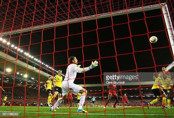 Dejan Lovren of Liverpool scores his team's fourth goal during the UEFA Europa League quarter final second leg match between Liverpool and Borussia...