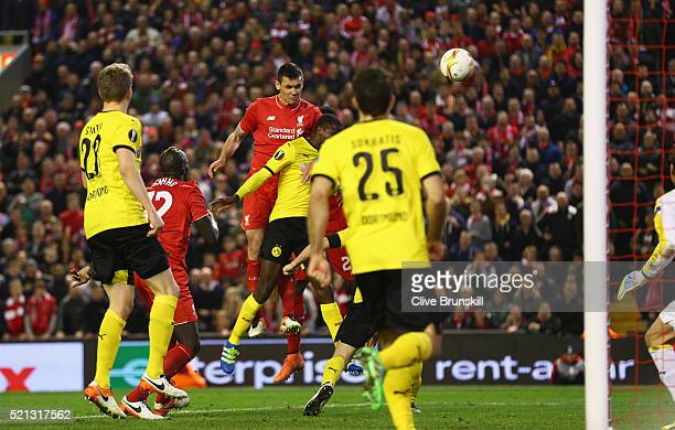 Dejan Lovren of Liverpool scores his team's fourth goal during the UEFA Europa League quarter final, second leg match between Liverpool and Borussia...
