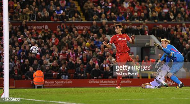 Dejan Lovren of Liverpool scores the winning goal during the Capital One Cup Fourth Round match between Liverpool and Swansea City at Anfield on...