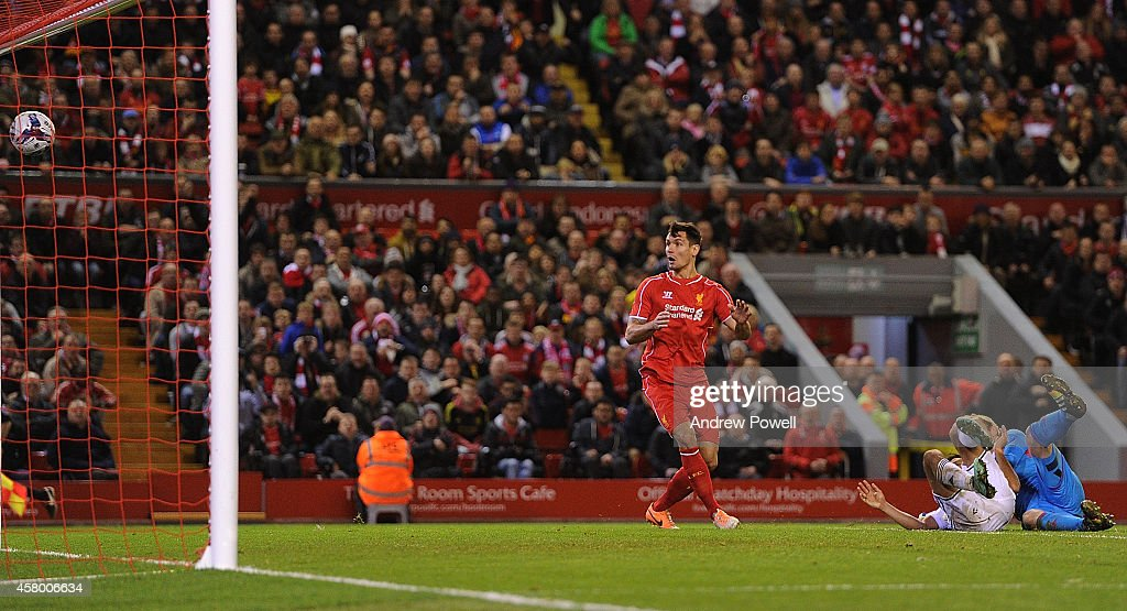 Dejan Lovren of Liverpool scores the winning goal during the Capital One Cup Fourth Round match between Liverpool and Swansea City at Anfield on October 28, 2014 in Liverpool, England.