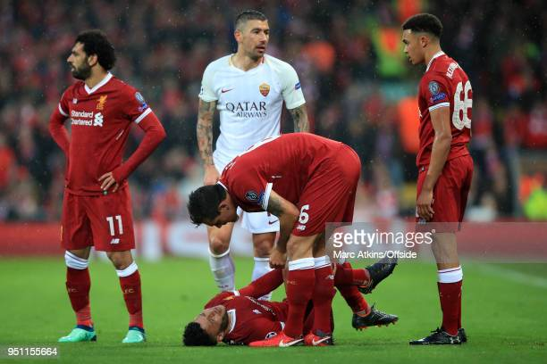 Dejan Lovren of Liverpool shows concern for the injured Alex OxladeChamberlain during the UEFA Champions League Semi Final First Leg match between...